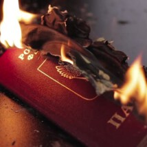 lit passport of the Russian Federation. passport on fire. documents to burn